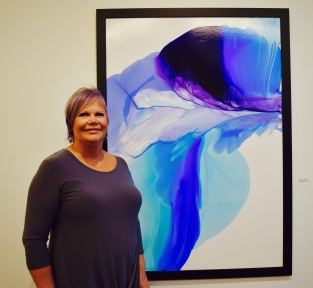 The talented artist in front of her work. I was impressed! It is my dream to have a gallery one day.