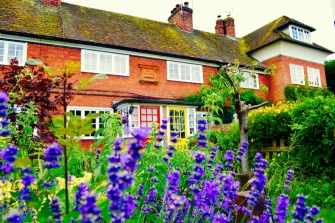A cute old cottage house, with a lovely English garden.