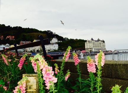 Along the pier of a seaside town in Wales.