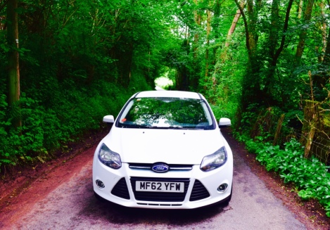 Road tripping around the lush forest of Wales in my brother car, Focus! I drive one of these back home but in blue!