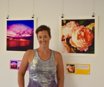 This is me standing in front of two of my images. One was the sunset at my Mums ashes ceremony, the other beautiful roses that crossed my path and reminded how amazing nature is.