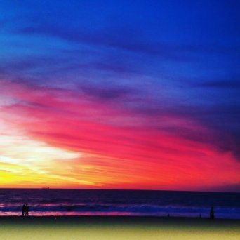 A very colourful sun setting at Scarborough beach amphitheatre, during a night of dancing.